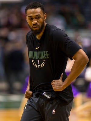 Jabari Parker and assistant Frank Johnson didn't immediately hit it off but eventually became close.
