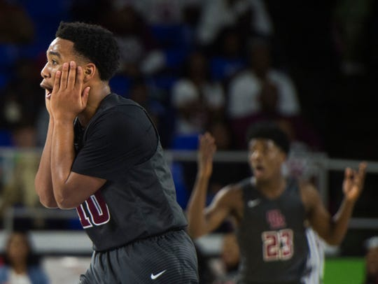 Oak Ridge's Levert Smith (10) reacts to a foul called