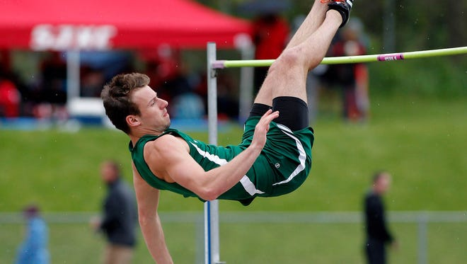 Williamston's Sy Barnett clears the bar in the high jump during the MHSAA Division 2 track regionals Friday, May 19, 2017, in Williamston, Mich.