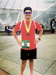 Anthony Luna Downs in a post-marathon photo during