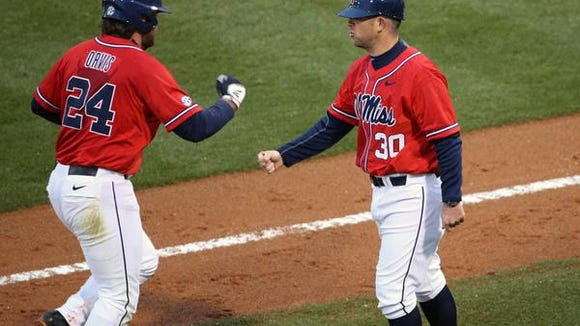 Ole Miss first baseman Sikes Orvis celebrates his home run against Wright State Friday.
