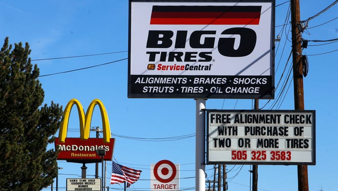 Businesses signs as seen on Nov. 18 along East Main Street in Farmington. Even as tax revenue from oil and gas production in the region drops, the retail sector is growing, making up some of the loss.