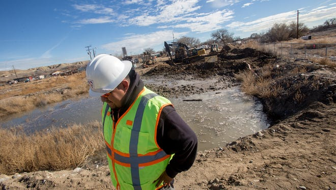 Gregory Bahe, operations supervisor for water and wastewater in the engineering, construction and operations division at Navajo Tribal Utility Authority, talks on Wednesday in Shiprock about repairs on a ruptured wastewater pipe.