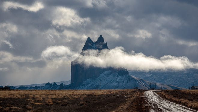 Rain clouds surround the Shiprock pinnacle on Monday off U.S. Highway 64 in Gadii'ahi, west of Shiprock.