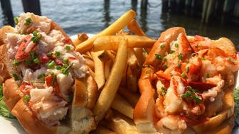 A pair of lobster rolls from Red's Lobster Pot in Point Pleasant Beach - one made with mayo, one with butter.