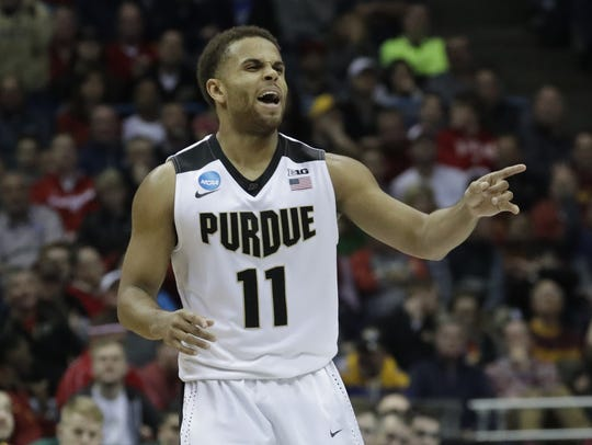 Purdue's P.J. Thompson celebrates during the second