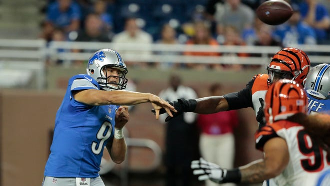 Detroit Lions QB Matthew Stafford looks for an open receiver against the Cincinnati Bengals during a pre-season game at Ford Field in Detroit on Thursday August 18, 2016.