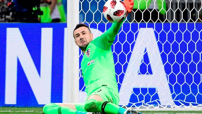 Croatia goalkeeper Danijel Subasic stops the ball in the penalty shootout against Russia.