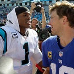 Eli Manning, right, and Cam Newton could be involved in a high scoring game Sunday