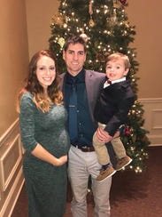 Charity, Josh and Alec Birkey pose for a family photo,