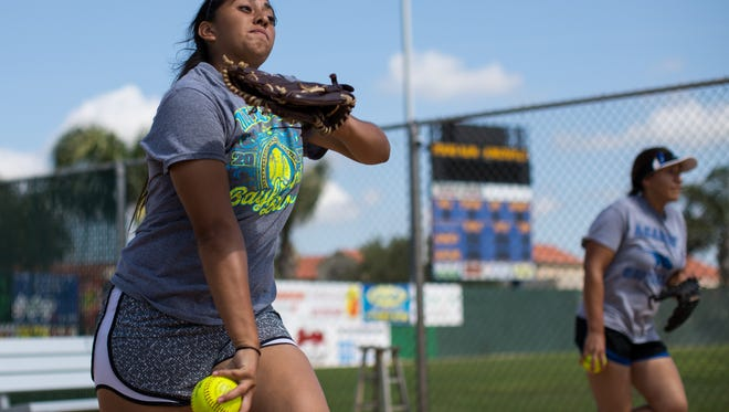 Santa Gertrudis Academy pitcher Saidi Castillo and Jackie De Los Santos warms up during practice at Texas A&M Kingsville Tuesday morning as they prepare for the state softball tournament.
