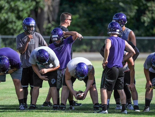 The Lakeview Spartans receive coaching instruction