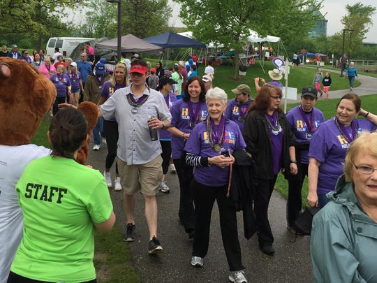 Cancer survivors follow the path through Heritage Park during a Relay for Life event in Canton.