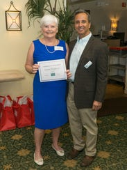 Joanne Dougherty, left, recognized for over 2,000 lifetime