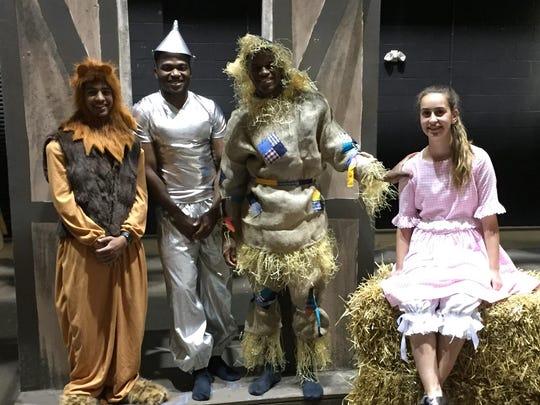 "Tatnall School's ""The Wizard of Oz"" cast members, from left, Dhruv Patel '16, Ike Osuagwu '16, Nate Memba '16 and Gianna Sparta '19."