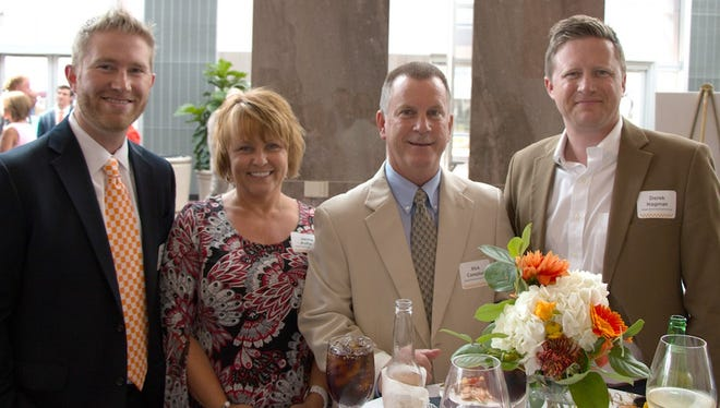 Business, community and University of Tennessee leaders gathered at the Knoxville Convention Center to formally welcome new UT Athletic Director John Currie and his wife, Mary Lawrence Currie, to Knoxville. Pictured here at the event are Brandon Stroud, Jackie Aulton, Rick Campbell and Derek Hagman, all of Regal Entertainment Group.