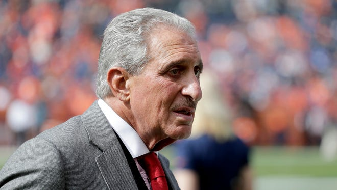 Atlanta Falcons owner Arthur Blank stands on the sidelines prior to an NFL football game against the Denver Broncos, Sunday, Oct. 9, 2016, in Denver.