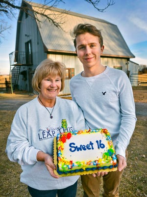 Angie Sauer, poses with her grandson, Cole Forner, Friday, Feb. 26, at her Clearwater home. Both celebrate 16 birthdays this year. That's because Sauer was born on a Leap Year Day.