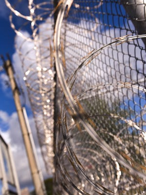 Coils of razor-wire and chainlink fencing serves as a deterrent for any unauthorized entries or exits at the Department of Corrections' Hagåtña Detention Facility, as seen on Friday, Feb. 16, 2018.