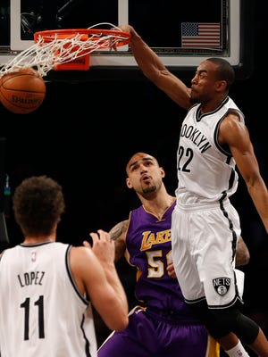 Brooklyn Nets guard Markel Brown dunks against Los Angeles Lakers center Robert Sacre  at Barclays Center.