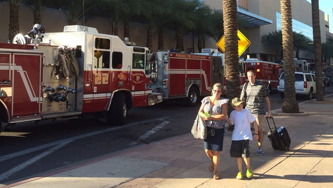 The Sheraton Phoenix Downtown Hotel will remain closed throughout the weekend as officials investigate the source of an electrical fire that filled parts of the building and nearby city streets with thick, acrid smoke. Guets were seen throughout the day with their bags leaving for other hotels Officials from the Sheraton and the city of Phoenix, which owns the hotel, continued to scramble Saturday night to find lodgings for the about 800 guests who were evacuated.