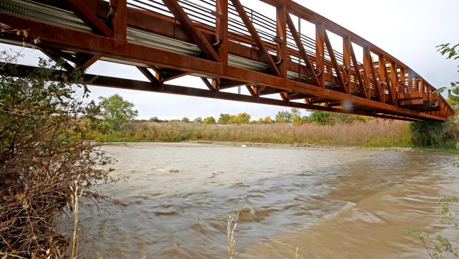 The Animas River flows near County Road 2900 on Wednesday in Aztec.