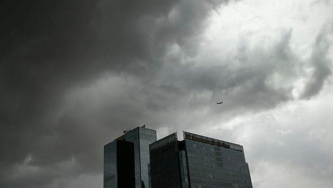 Storm clouds gather in downtown Phoenix on May 15, 2015.