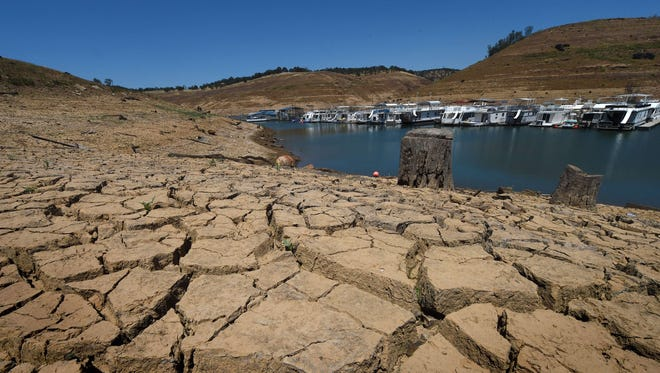 Dried mud and the remnants of a marina are seen at the New Melones Lake reservoir, which is now at less than 20% capacity as a severe drought continues to affect California on May 24, 2015.