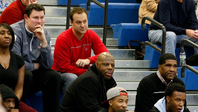 (L-R)  Bellarmine assistant coach Damien Anderson sat with Louisville assistants Mike Balado, Wyking Jones and Kenny Johnson as they watched the Trinity-St. X game during the LIT tourney at Valley High School.Jan. 14, 2014