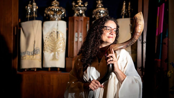 Rabbi/Cantor Meeka Simerly of Temple Beth Tikvah in Wayne, taped services for the Jewish High Holidays, Rosh Hashanah and Yom Kippur in July. The shofar, held by Rabbi Simerly, made of a rams horn, is blown during the Jewish High Holy Days.