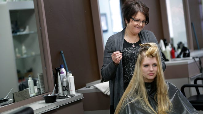 Stylist Kerri Miller gives a highlight treatment to Rachel Gradl of Freedom at the Gallery On Hair & Day Spa in Appleton. Miller was diagnosed with breast cancer and had surgery in 2010. She had chemotherapy and radiation in 2011 and is fine today.