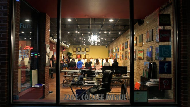 Pinot's Palette, which opened recently in the former Conkey's building in downtown Appleton, makes painting a night life activity.