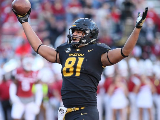 Missouri Tigers tight end Albert Okwuegbunam (81) celebrates after scoring a touchdown in the second quarter against the Arkansas Razorbacks at Donald W. Reynolds Razorback Stadium.