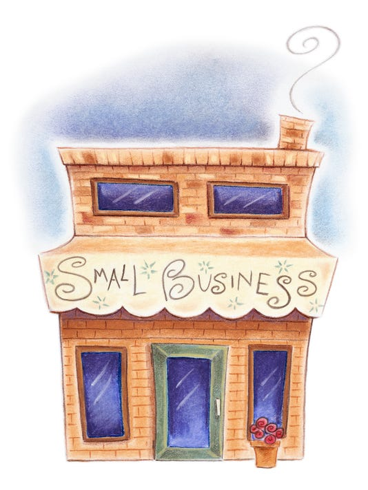 Brick building with Small Business written on awning