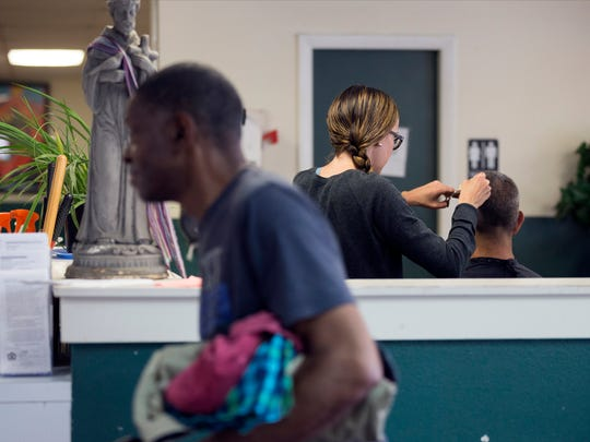 Homeless men gather at the St. Francis Center for meals, service referrals and haircuts in Denver, Colo., Monday, June 18, 2018. The shelter has served increased numbers of homeless people since the legalizationof recreational marijuana.
