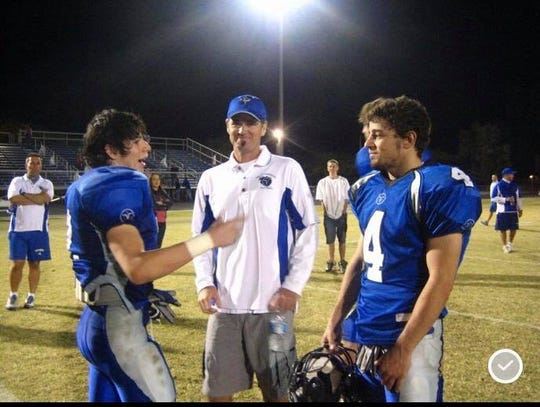 Justin Lett (left) after a high school football game