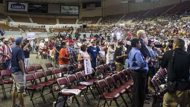 Empty seats are seen during a rally for Republican presidential candidate Donald Trump on Saturday, June 18, 2016, at Veterans Memorial Coliseum in Phoenix.