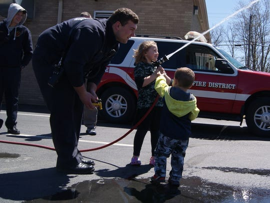 A New Hackensack firefighter shows kids how to use