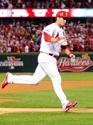David Freese rounds the bases after his second-inning homer.