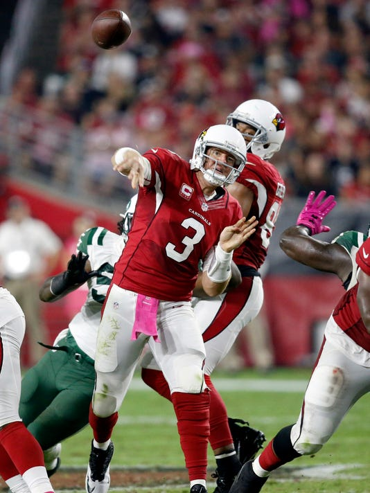 Arizona Cardinals quarterback Carson Palmer (3) throws against the New York Jets during the second half of an NFL football game, Monday, Oct. 17, 2016, in Glendale, Ariz. (AP Photo/Ross D. Franklin)