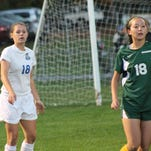 Amelia's Abby Brown (white jersey) started every game at defender for the Lady Barons last season.