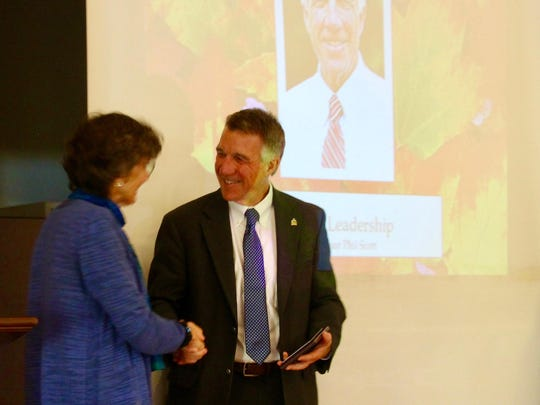 COTS Executive Director Rita Markley presents the Leahy Leadership Award to Gov. Phil Scott on Oct. 27, at the COTS Annual Meeting.