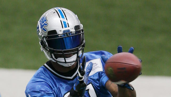 Detroit Lions NFL football wide receiver Calvin Johnson makes a catch during organized team activities at the Lions training camp facility in Allen Park, Mich., Wednesday, May 21, 2014.