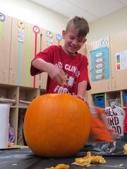 Brayden Boyle gives a pumpkin a scientific examination.