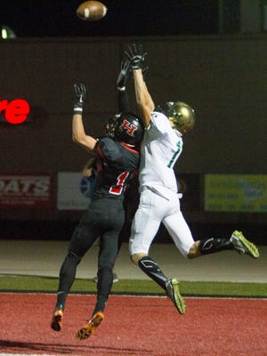 Wide receiver Zach Nowatzke, pictured against Hurricane last season, is one of Snow Canyon's top returning players this season.