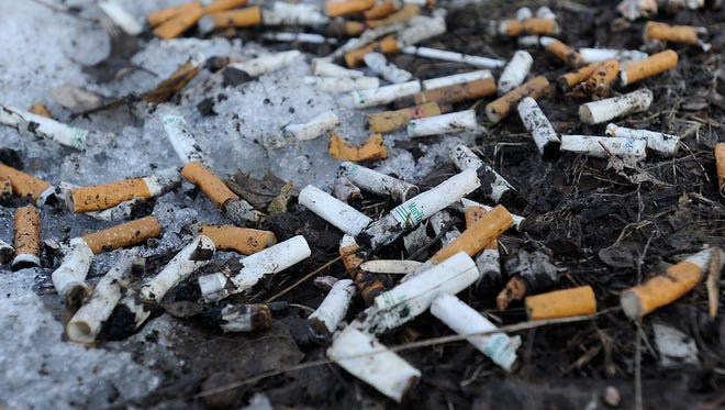 Cigarette butts are shown on the ground around the property owned by Avera at 7th Avenue and 20th Street.