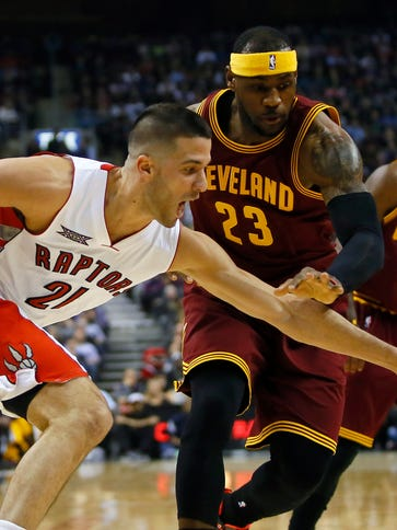 Toronto Raptors guard Greivis Vasquez reaches for a