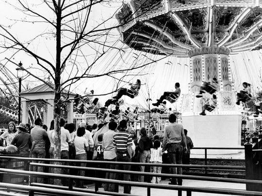 Visitors to Opryland U.S.A. theme park enjoy one of the newer rides at the entertainment complex on the first day of the 1977 season April 9, 1977. Opryland will be open weekends only until May 30, when it will be open seven days a week.