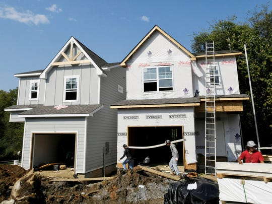 """East Nashville: Construction crews work on a pair of homes in East Nashville on Sept. 21, 2017. Two """"tall skinny"""" homes can be built on one lot when they are 6 feet apart, among other conditions."""