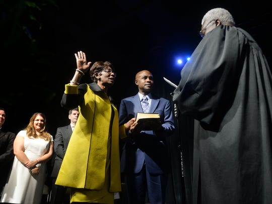 Ollie Tyler takes the oath for the office of as mayor